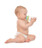 Infant child baby toddler sitting and drinking water from the fe Royalty Free Stock Image
