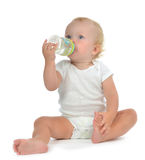Infant child baby toddler sitting and drinking water Stock Image