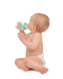 Infant child baby toddler sitting and drinking water Stock Photography