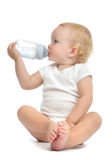 Infant child baby toddler sitting and drinking water Royalty Free Stock Photos