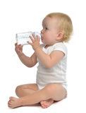Infant child baby toddler sitting and drinking water Royalty Free Stock Image