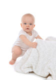 Infant child baby toddler sitting and eating soft blanket towel Royalty Free Stock Photos