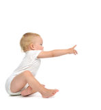 Infant child baby toddler sitting with hand pointing finger stra Stock Photography