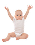 Infant child baby toddler sitting hands up Stock Image