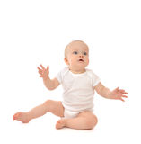 Infant child baby toddler sitting hands up surprised Stock Photography