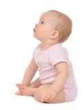 Infant child baby toddler sitting happy looking at the corner Royalty Free Stock Images