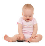 Infant child baby toddler sitting laughing looking down Stock Images