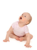 Infant child baby toddler sitting looking up and yelling Royalty Free Stock Photos