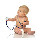 Infant child baby toddler sitting with medical stethoscope for p. Hysical therapy on a white background Royalty Free Stock Images