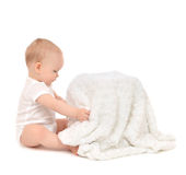 Infant child baby toddler sitting and open soft blanket towel Royalty Free Stock Image