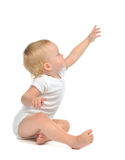 Infant child baby toddler sitting raise hand up pointing finger Stock Photo