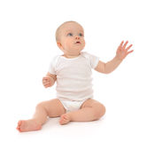 Infant child baby toddler sitting raise hand up pointing fingers Royalty Free Stock Photos