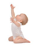 Infant child baby toddler sitting raise hands up Stock Image