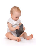 Infant child baby toddler sitting and typing digital tablet mobi Royalty Free Stock Photography
