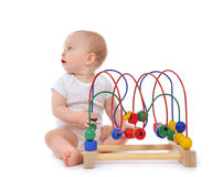 Infant child baby toddler standing and playing wooden educationa Royalty Free Stock Photo