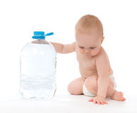 Infant child big bottle of drinking water Stock Photo