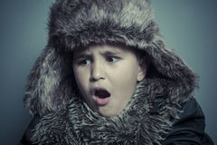 Infant child with fur hat and winter coat, cold concept and stor Royalty Free Stock Images