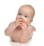 Infant child girl lying happy holding baby nipple soother Royalty Free Stock Photography