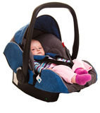 Infant child sitting in car seat Stock Photography