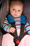 Infant child sitting in car seat Royalty Free Stock Images