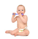 Infant child toddler kid sitting eating purple spoon sitting iso Royalty Free Stock Photos