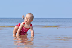 Infant child in water Stock Image