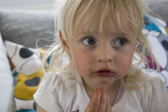 Infant with chocolate mouth Stock Image