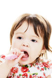 Infant cleans teeth Stock Photos