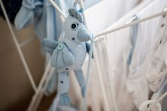 Infant laundry and soft toy blue bird Royalty Free Stock Photos