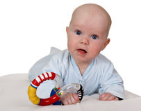 Infant with colored plastic toy Stock Photography