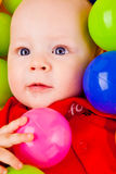 Infant with colorful balls Royalty Free Stock Images