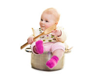 Infant in cooking pan Stock Photo