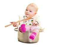 Infant in cooking pan Stock Image