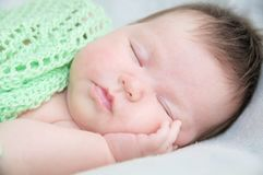 Infant cute baby sleeping portrait lying on arms. Infant cute newborn baby sleeping portrait lying on arms, silence time Stock Photography