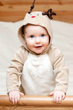 Infant in deer costume Stock Photos