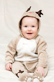 Infant in deer costume Stock Images