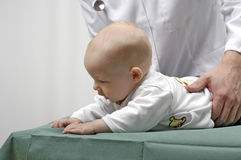 Infant with a doctor Royalty Free Stock Photos
