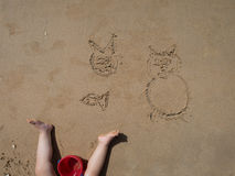 Infant drawings on sand Stock Photos