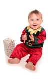 Infant dressed in elfs santas little helper fancy dress costume. Cutout Royalty Free Stock Images