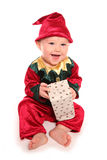 Infant dressed in elfs santas little helper fancy dress costume. Cutout Royalty Free Stock Photography