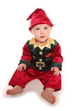 Infant dressed in elfs santas little helper fancy dress costume. Cutout Royalty Free Stock Image