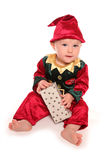 Infant dressed in elfs santas little helper fancy dress costume. Cutout Stock Photography