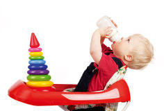 Infant drinking milk Royalty Free Stock Image