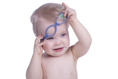 Infant with eyeglasses. One year old boy with blue eyeglasses Stock Photos