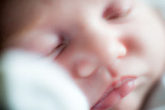 Infant face sleeping. Infant face close-up, focus on lips stock photography