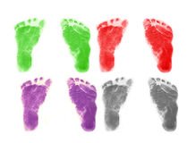 Infant Footprints. Set of infant 's footprints in four colors Stock Photos