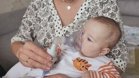 Infant getting breathing treatment from mother while suffering from illness. Infant getting breathing treatment from mother while suffering from illness stock video footage