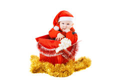 Infant with gifts in the christmas box Royalty Free Stock Photos