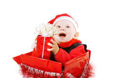 Infant with gifts in the christmas box Royalty Free Stock Images