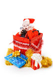 Infant with gifts in the christmas box Royalty Free Stock Photo